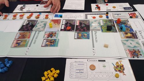 A very early Oath prototype, laid out on a table with players engaged