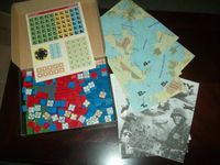 Assortment showing maps, instructions and blocks from the starter set and expansions.