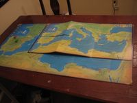 24.5 x 47.8 map on chipboard.  6 hinged boards butted together.  All hinges on non map side.