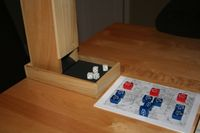 Dice tower in action with simplified CG battle board