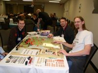 Eastfront II in play Saturday at BGG.Con 2006. The large map was no problem here! From left, Matt [Dr Glaze et al], Ben [SabreRedleg], & Rusty [kuhrusty]