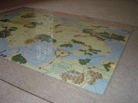 "Covering your maps with a 30""x36"" clear plexi to protect, prevent slips, make it look nicer, etc. Cost: $12"