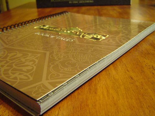 The thick Book of Tales probably accounts for 75% of the game's weight.