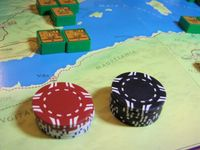 Julius Caesar Solo: White Casino Chips are used to denote victory points for cities with the exception of Rome which has Red Casino Chips. The Black Chips are for casualties amongst the leaders.