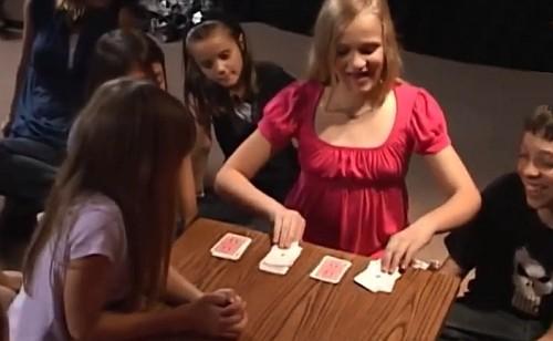 girl performing card tricks