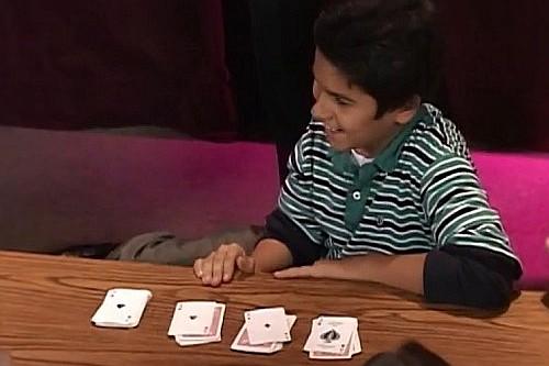 kid performing card tricks