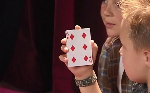kid doing card trick