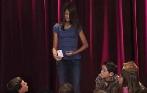 kid performing card trick