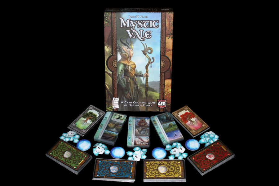 An arrangement of the components and cards in Mystic Vale