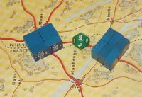 A few twelve-sided dice (d12) can be used to record the number of units advancing down a road until the limit is reached.