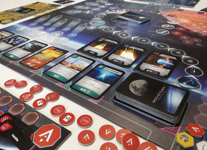 Martin Wallace's Rocketmen. Game setup with Asset and Engine cards on the first plan.