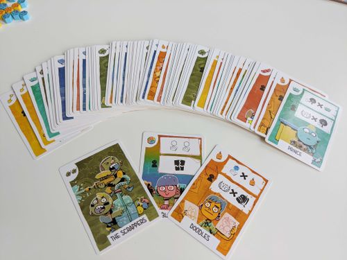 """A fan of the """"kid"""" cards from Fort. Viewable names include Prince, The Scrappers, and Doodles"""