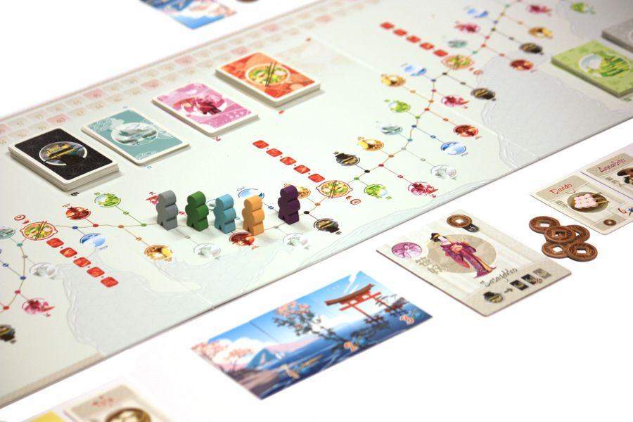 A picture of the board game Tokaido, mid-game.