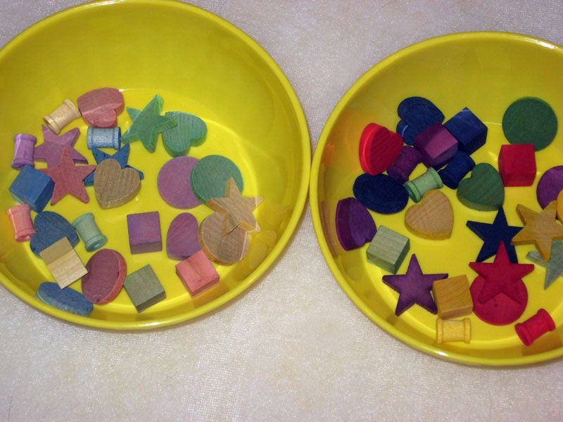 Comparison of game pieces offered by Pair-of-Dice using new dyeing method (right) with old pieces.