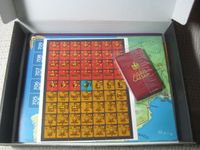 The stickers & cards in the box.  The map is below them.