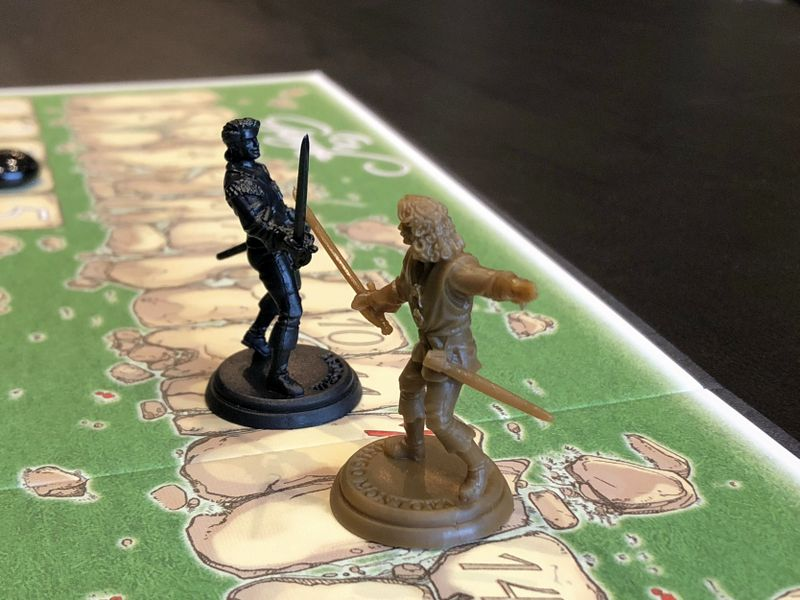 Finally, playing En Garde the way it was meant to be played—with figures from The Princess Bride Adventure Book Game.